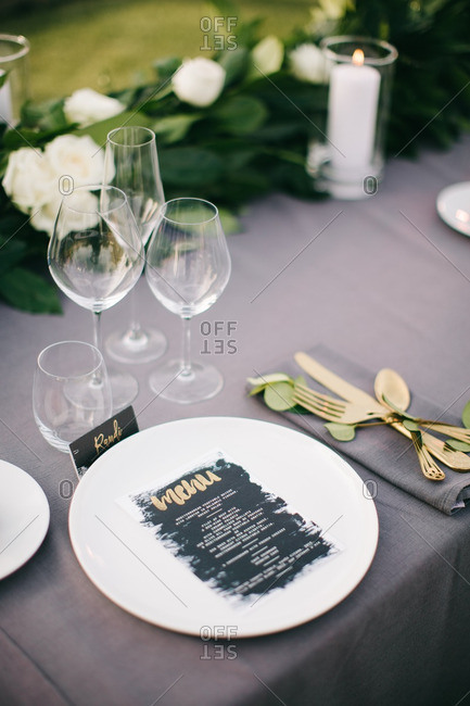 Menu on wedding table place setting