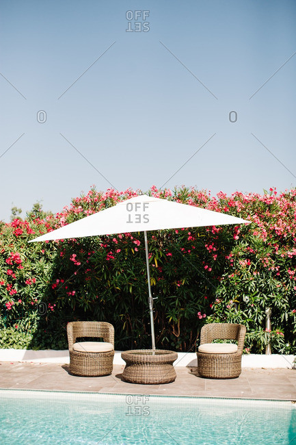 Chairs and table at poolside