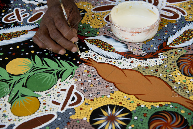 Detail of an artist painting in a traditional aboriginal style, in Darwin, Australia