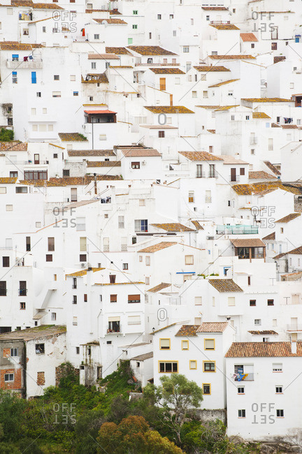 Multi-storey white buildings with tile rooves in Casares, Spain