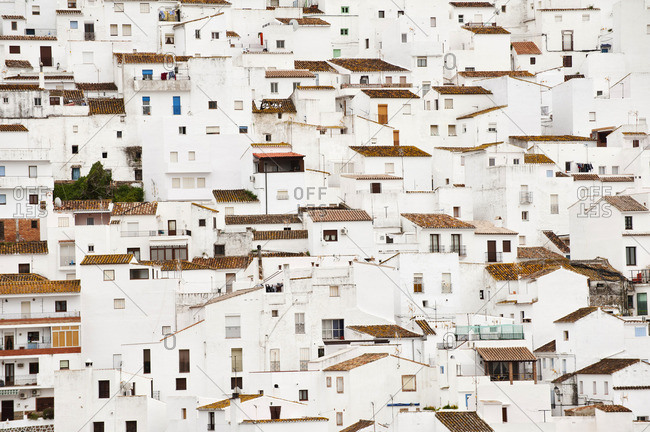 White buildings with tile rooves on a hillside in Casares, Spain