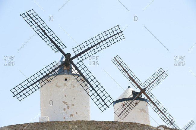 Old windmills behind a stone wall in Consuegra, Spain