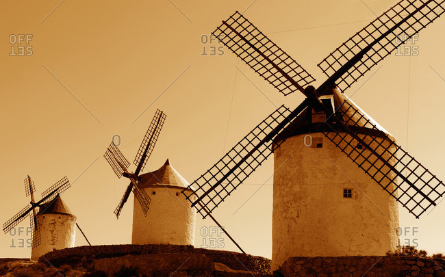 Old windmills at sunset in Consuegra, Spain