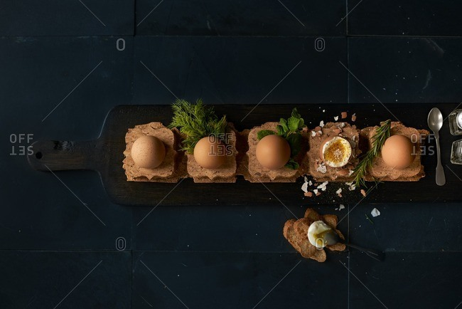 Cooked eggs on cork board shapes