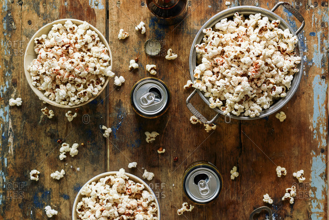Bowls of popcorn and cans of beer