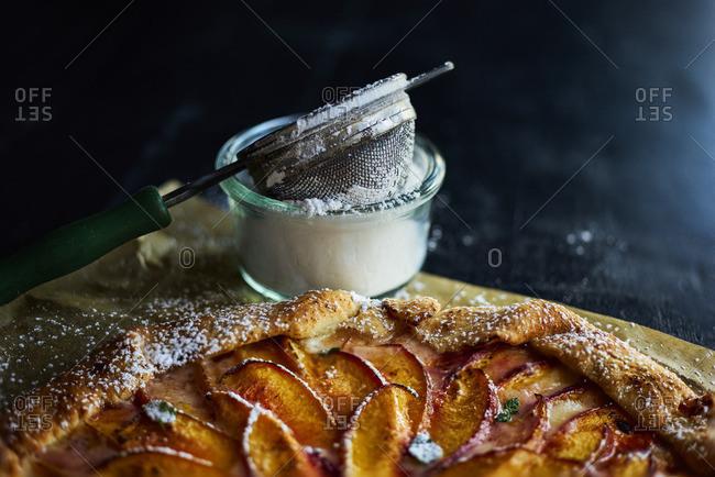 Peach tart by powdered sugar