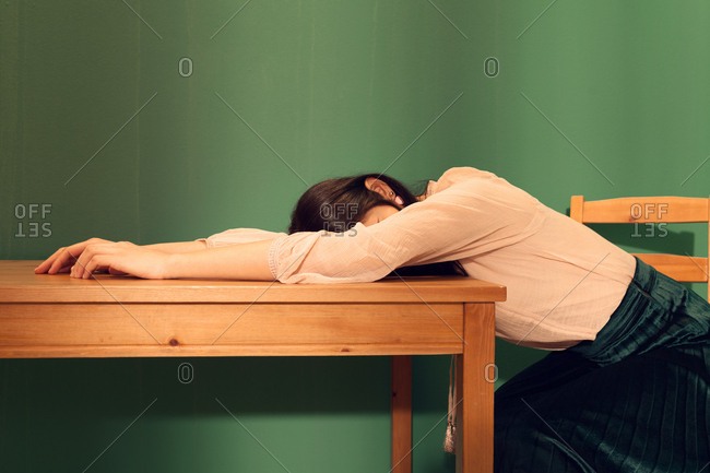 Woman sitting on a chair and lying on a table