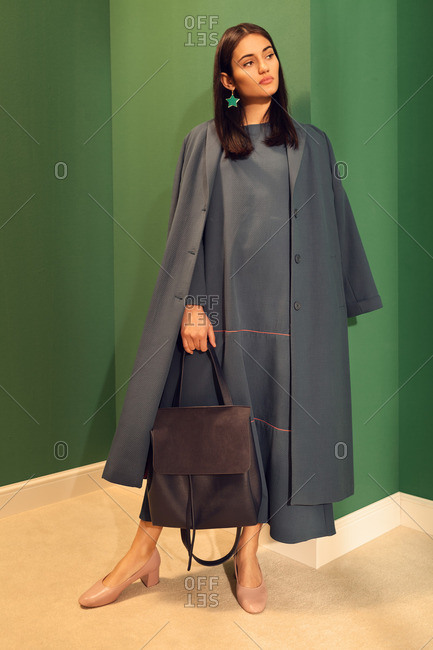 Fashionable young woman wearing blue coat