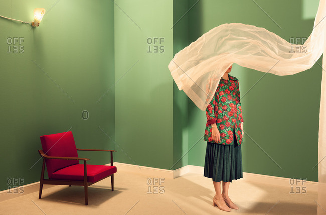 Young woman wearing floral jacket in a green room