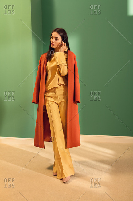 Fashionable young woman wearing orange and yellow outfit