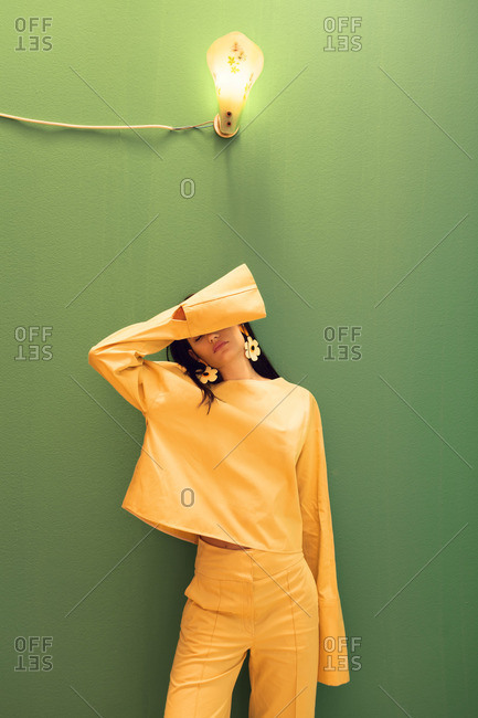 Woman wearing yellow trendy suit