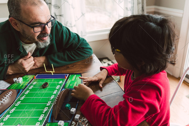 Father and son playing a tabletop football game