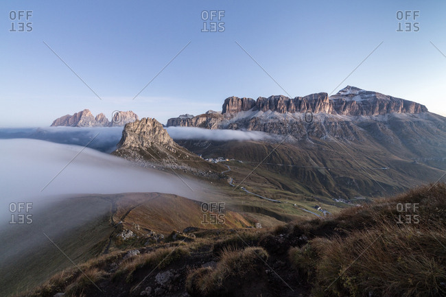 Piz Boa Sassolungo and Sass Beca shrouded in morning fog Cima Belvedere, Canazei, Val di Fassa, Trentino-Alto Adige, Italy, Europe
