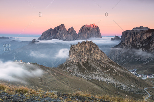 Pink sky and mist on Sass Beca and Sassolungo seen from Cima Belvedere, Canazei, Val di Fassa, Trentino-Alto Adige, Italy, Europe