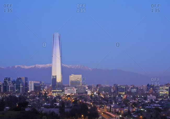 Twilight view from the Parque Metropolitano towards the high rise buildings and Costanera Center Tower