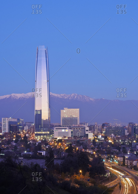 Twilight view from the Parque Metropolitano towards the high raised buildings with Costanera Center Tower