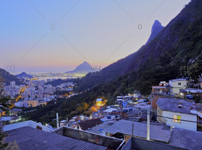 Twilight view of the Favela Santa Marta with Corcovado and the Christ statue behind