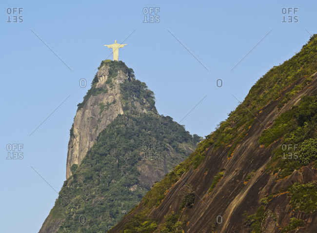 Christ the Redeemer statue on top of the Corcovado Mountain viewed from Santa Marta