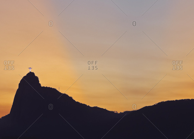 Sunset view of Christ the Redeemer statue and Corcovado Mountain