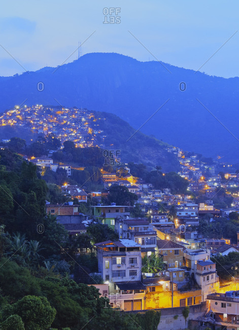 Twilight view of the favelas Unidos de Santa Teresa Morro do Escondidinho and Morro dos Prazeres, Rio de Janeiro, Brazil, South America