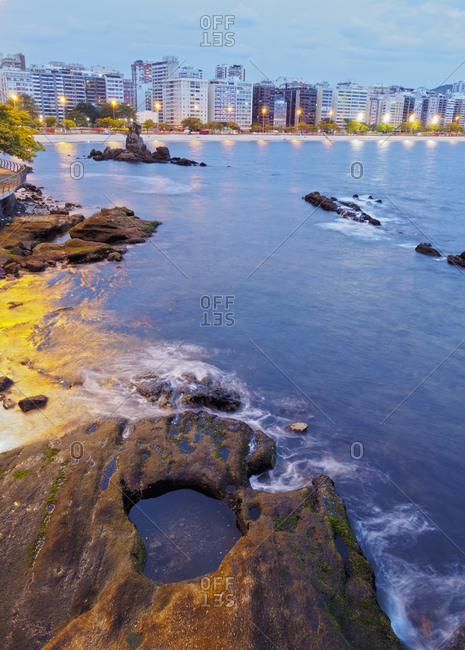 Twilight view towards Icarai Beach with skyline of Niteroi, Niteroi, Rio de Janeiro, Brazil, South America
