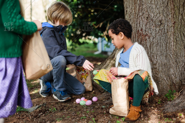 Children participating in an outdoor egg hunt