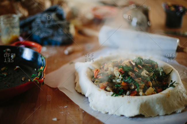 Cooked vegetables in a pie crust