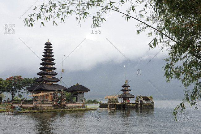 Indonesia, Bali, Bedugul, the temple of Ulun Danu is located on the shores of Lake Bratan. The Temple with its Atap Meru (bunk roofs) of 11 roofs is dedicated to the goddess of the waters