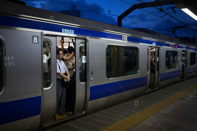 Tokyo, Japan - September 3, 2013: Japan, Tokyo, Closing the doors of a crowded subway full of people going home from work