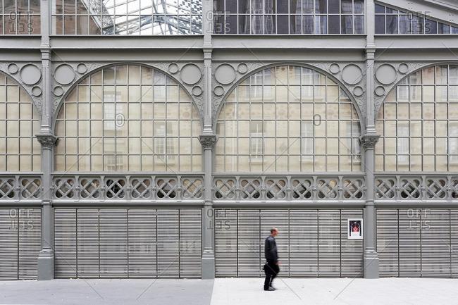 France, Paris, 3rd arrondissement. The Carreau du Temple. Parisian passing the Carreau du Temple.