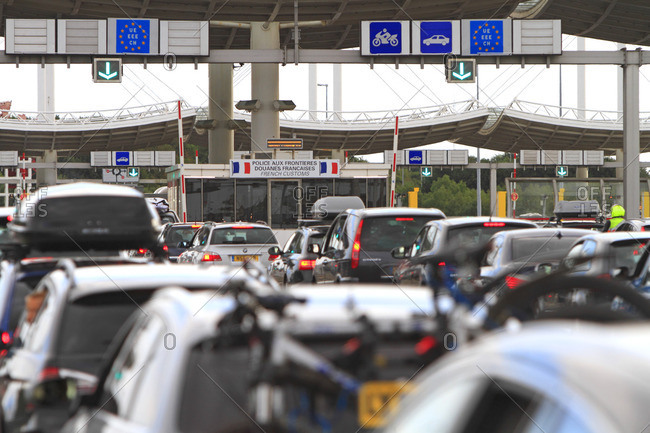 France - August 31, 2014: France, traffic jam at customs, border in Eurotunnel area on the French side. Englsih coming home from vacation.