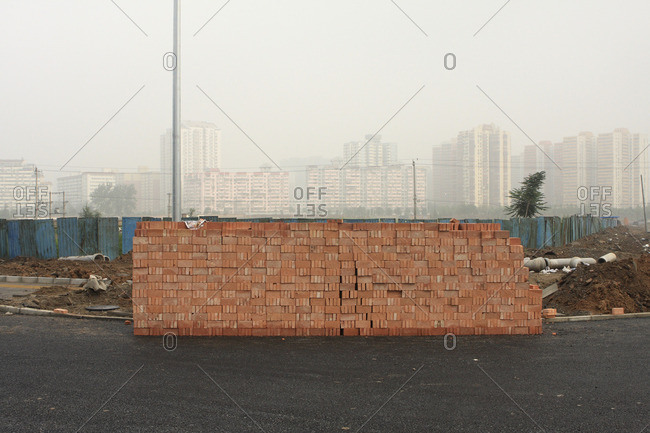 China, Beijing, Pile of bricks constituted by bricks collected by women in a destroyed hutong