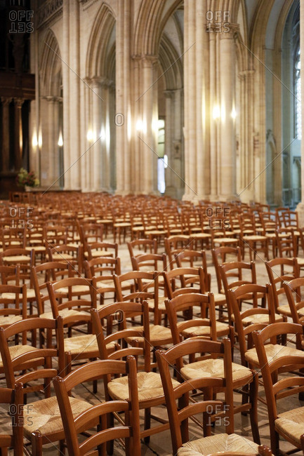 France, Normandy. Manche. Coutances. Deserted cathedral of Coutances. Alignment of empty chairs.