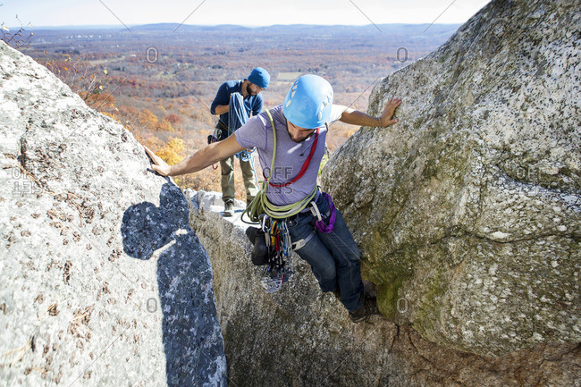 High angle view of friends rock climbing