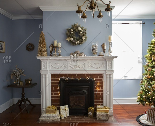 Christmas tree by fireplace with decoration at home