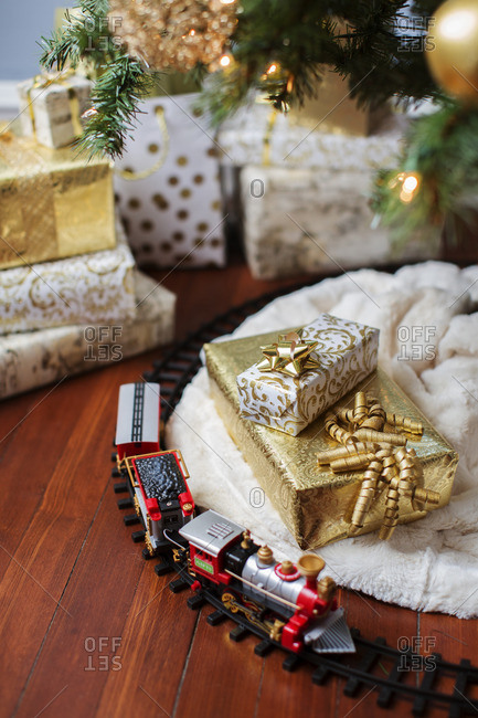 High angle view of miniature train and gift boxes