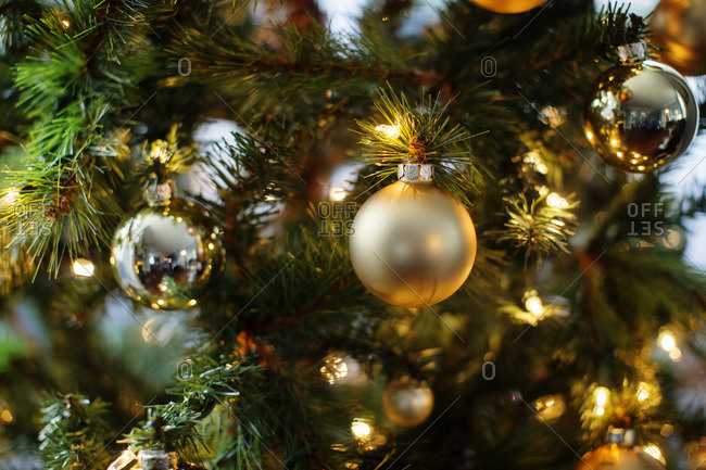 Close Up Of Ornaments And Lights On Christmas Tree