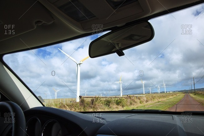 Windmills seen through car windshield