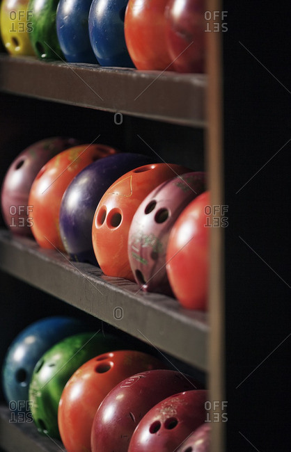 Close-up of bowling ball arranged on shelf