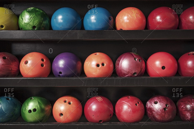 Bowling ball arranged on shelf