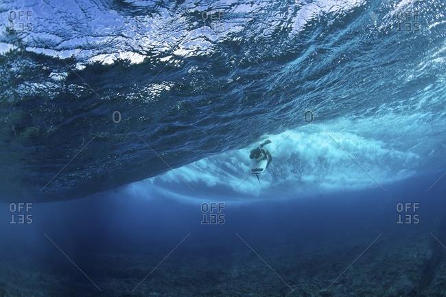 Man surfing underwater in sea