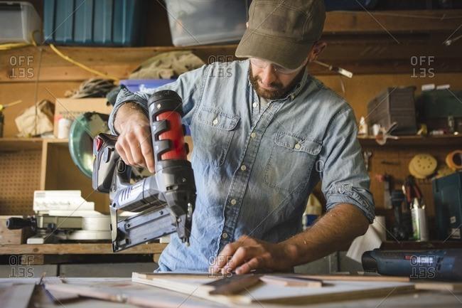Nail art stock photos offset artist using nail gun on wooden art at workshop prinsesfo Images