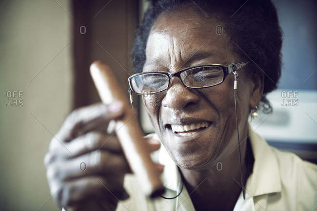 Happy woman showing cigar - Offset