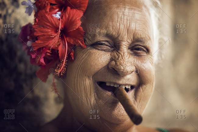 Close-up of portrait of woman with cigar in mouth