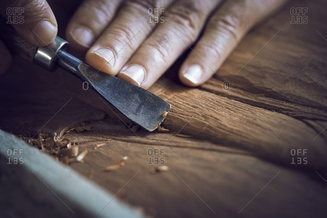 Cropped image of man carving in workshop