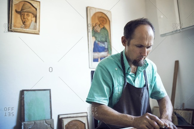 Craftsperson carving in workshop