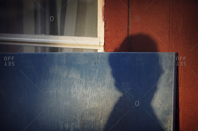 Shadow of woman on wall