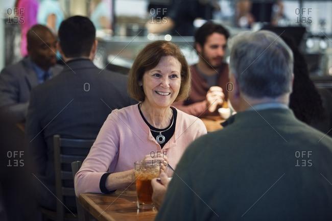 Senior couple having food in restaurant