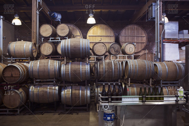 Barrels arranged in warehouse at brewery