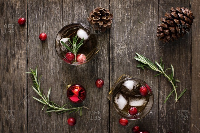 Overhead view of drinks with pine cones on wooden table